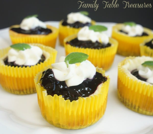 Lemon Cheesecake Cupcakes {with Blueberry Sauce